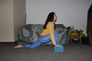 Low Lunge: Notice that my ankle is stacked below the knee and that I am leaning forward into the front leg.