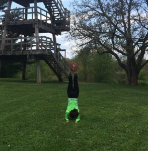 This is me practicing forearm stand, confidently, in my running shoes, when I thought no one was watching.