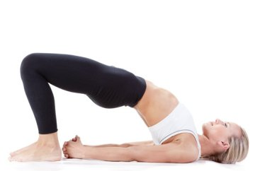 Bridge Pose: A great posture to undo some of the harm from being seated often and to build hip and core strength