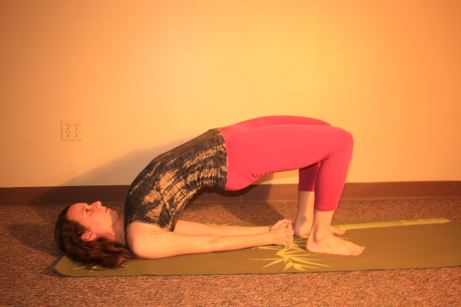 Full Bridge: bring your shoulders underneath you a little and interlace the fingers. The higher you go up, the deeper the backbend you will be in.