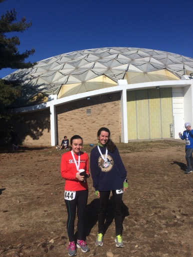 Lizzy and I at the finish of the Holy Half with our medals!